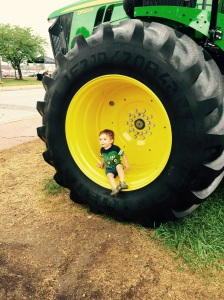 Cole, refusing to get out of the tractor wheel at the State Fair.